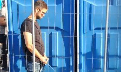 handsome guy caught peeing in public during festival