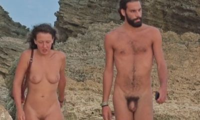 straight nudist guy walking on the beach