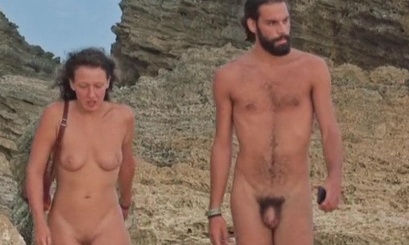 straight nudist guy walking on the beach