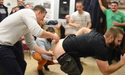 rugby guy pantsed and bending over