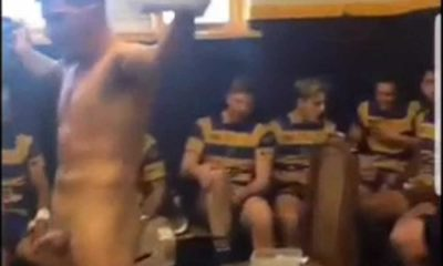 rugby player with cock out for locker room celebration