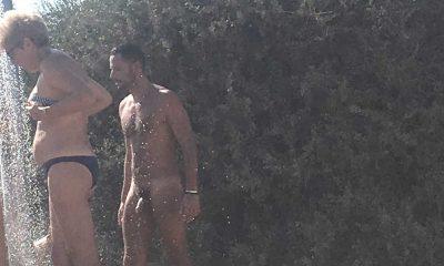 nudist man showering at the naturist beach