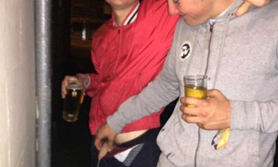 guy touching friend dick while peeing
